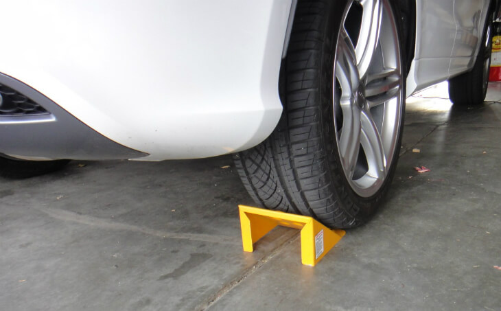Place a wheel chock on the opposite side of the lifting point.